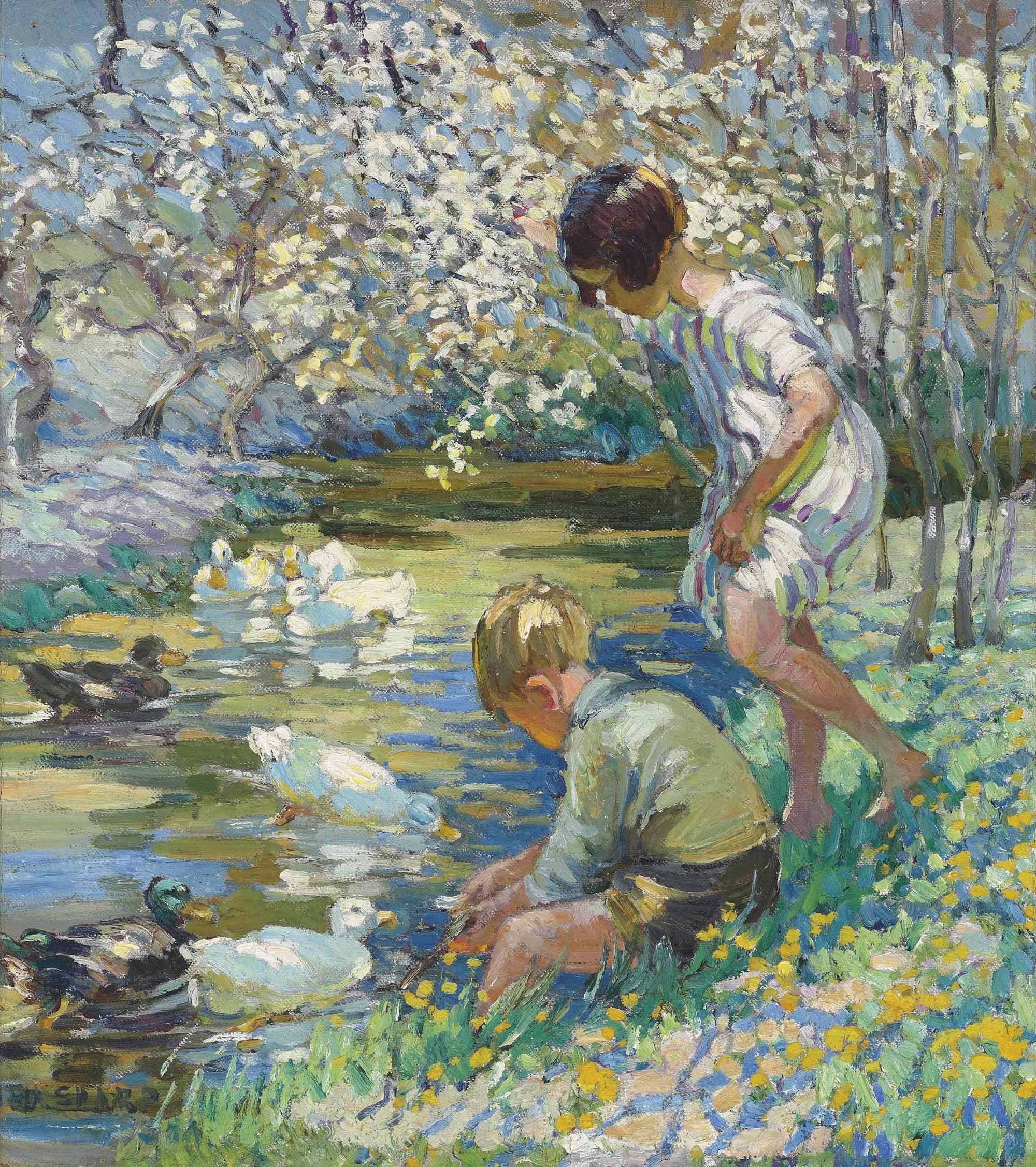 Children playing beside a stream