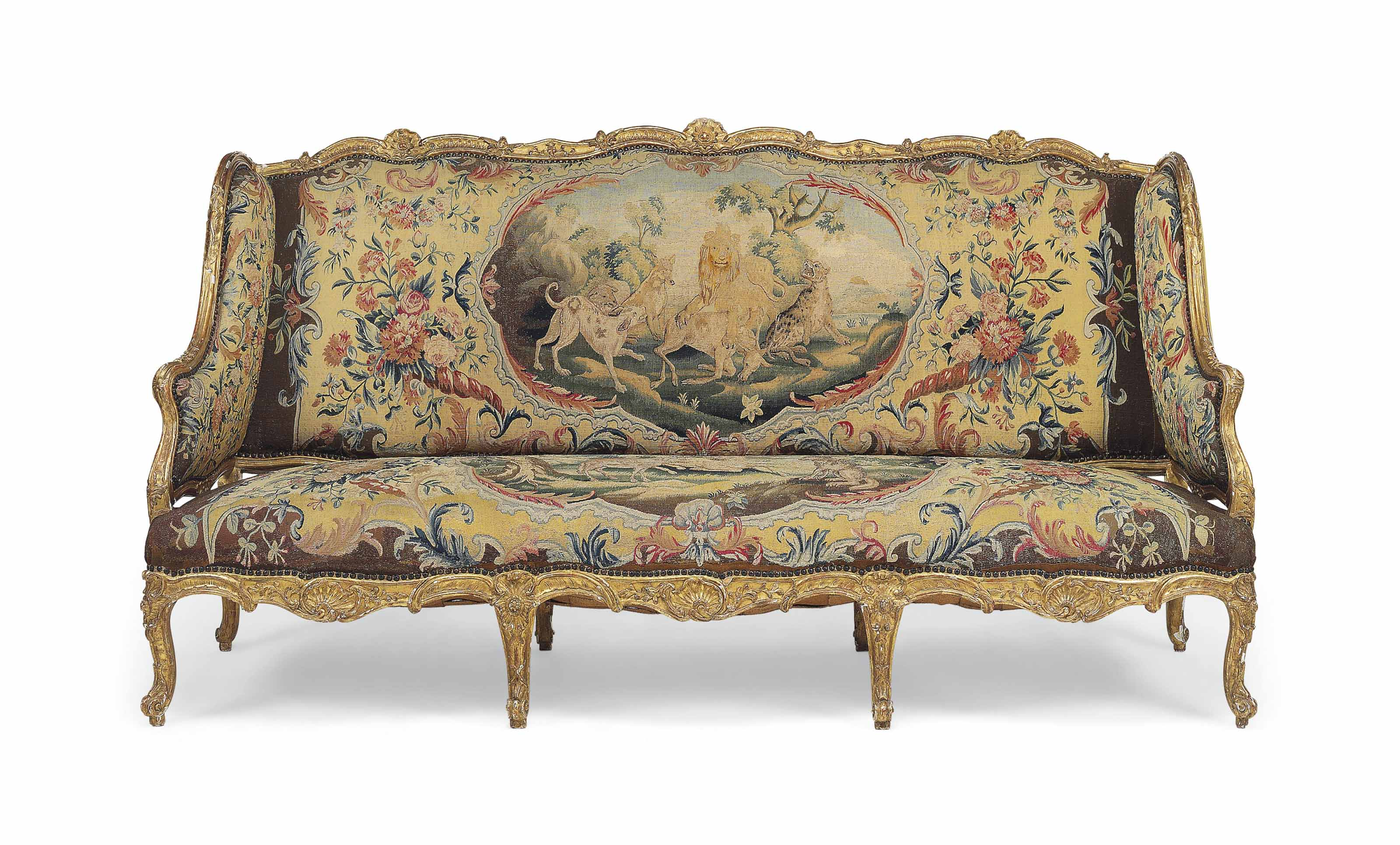 AN EARLY LOUIS XV GILTWOOD AND BEAUVAIS TAPESTRY CANAPE A OREILLES