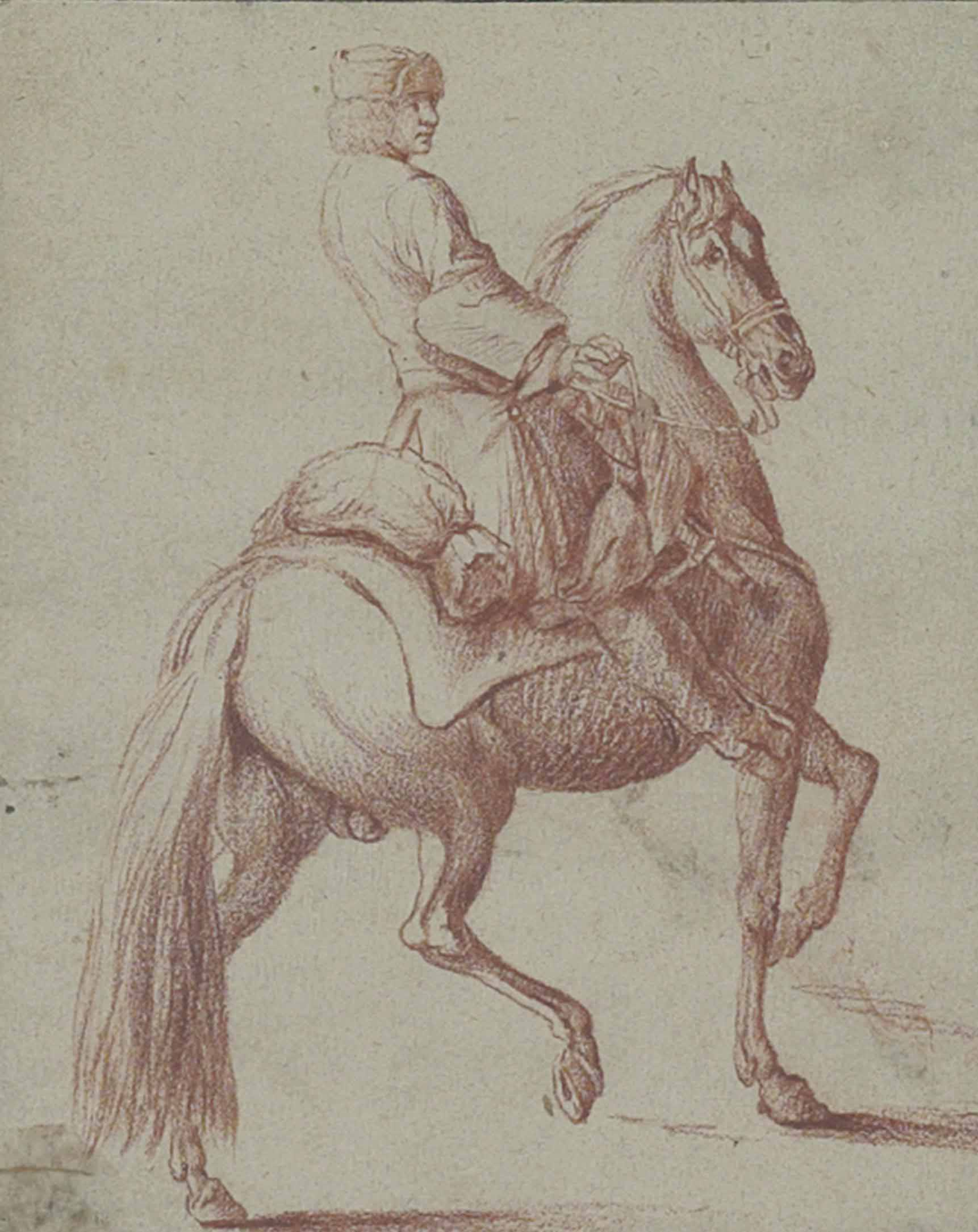 A mounted horseman (recto); Study of a melancholic head (verso)