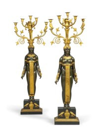 A PAIR OF EMPIRE ORMOLU, PATINATED BRONZE AND BLACK FOSSIL MARBLE SIX-LIGHT CANDELABRA