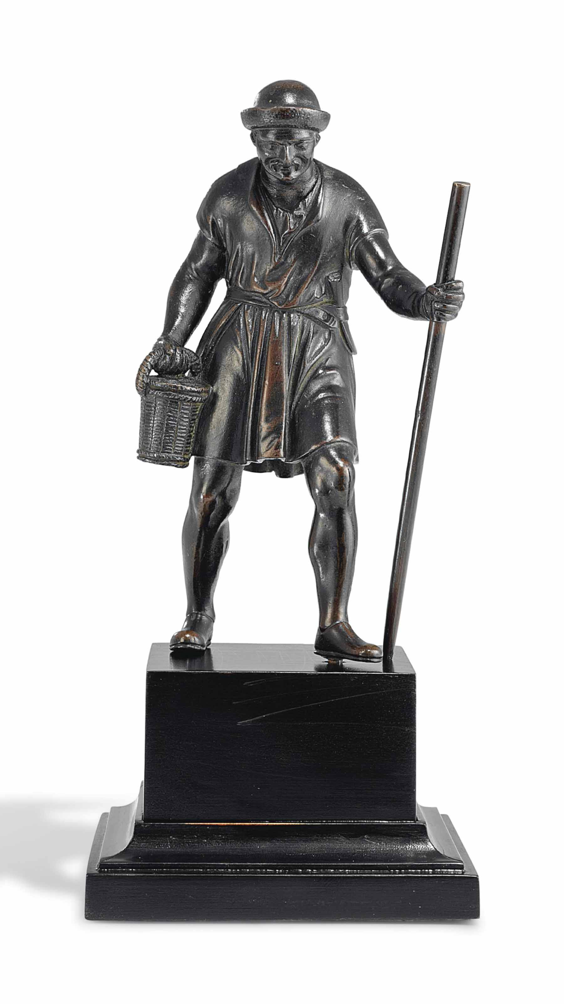 A BRONZE FIGURE OF A HARVESTER