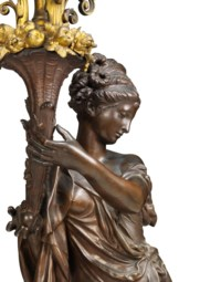 A PAIR OF FRENCH ORMOLU AND PATINATED-BRONZE FIGURAL FOUR-LIGHT TORCHERES, ON PEDESTALS