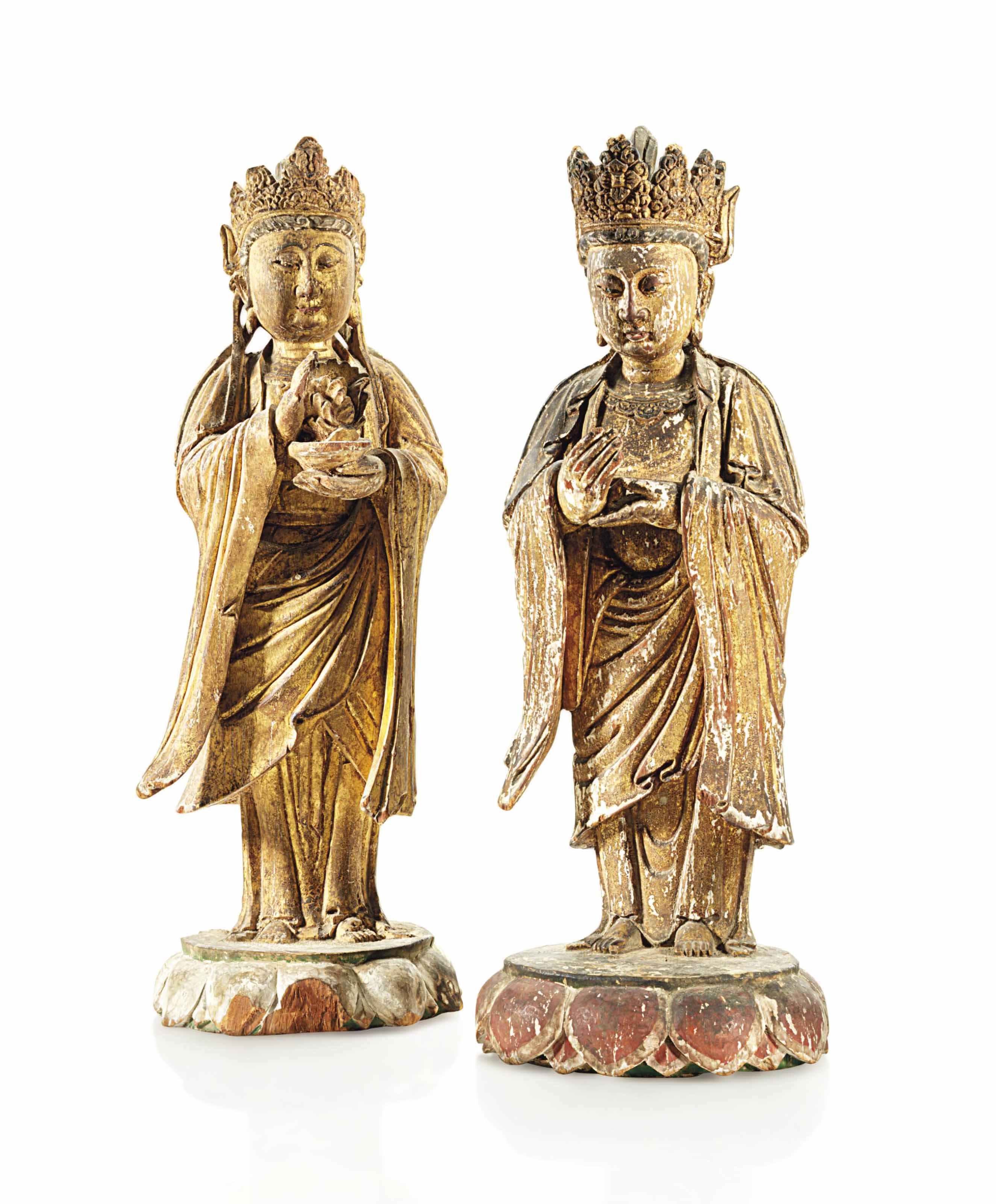 A PAIR OF GILT AND PAINTED WOO
