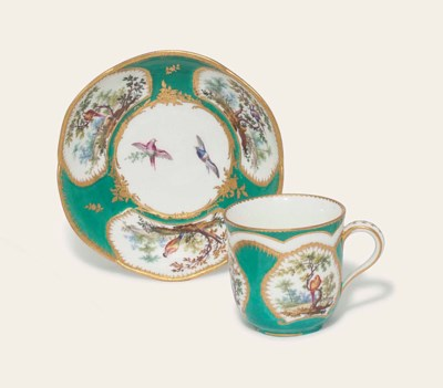 A SEVRES GREEN-GROUND CUP AND