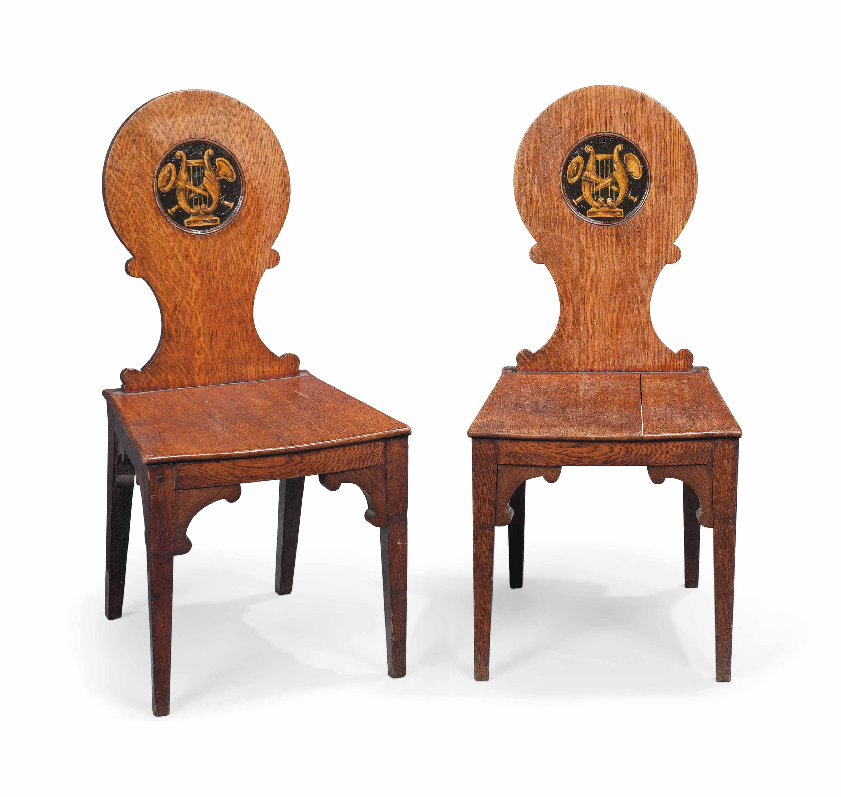 A PAIR OF REGENCY OAK HALL CHAIRS