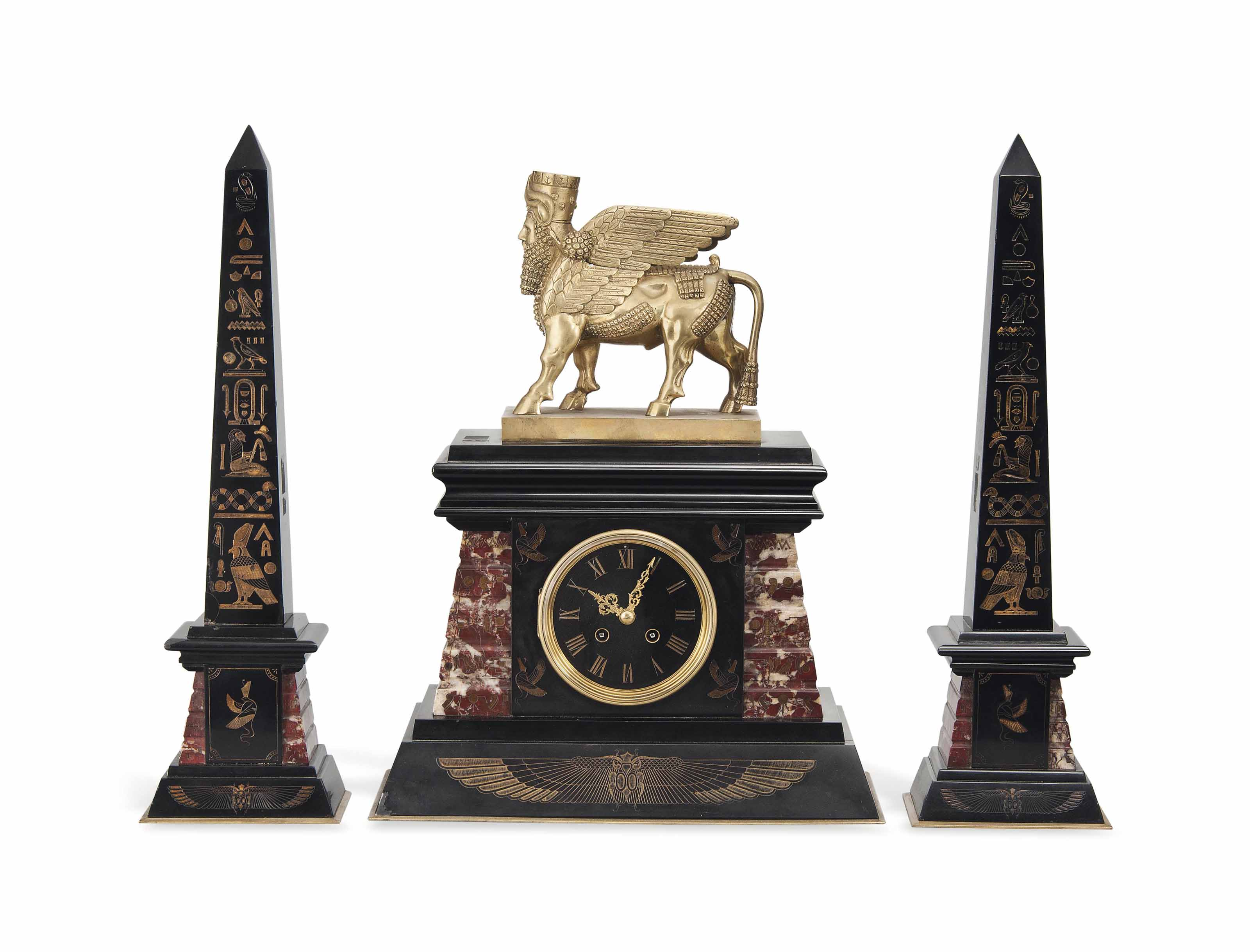 AN EGYPTIAN REVIVAL GILT-BRONZE AND MARBLE THREE-PIECE CLOCK GARNITURE
