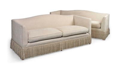 A PAIR OF CREAM-COVERED SOFAS