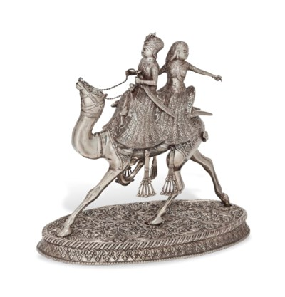 AN INDIAN SILVER STATUE OF A C