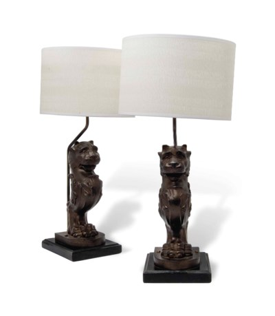 A PAIR OF CAST-IRON LION SUPPO