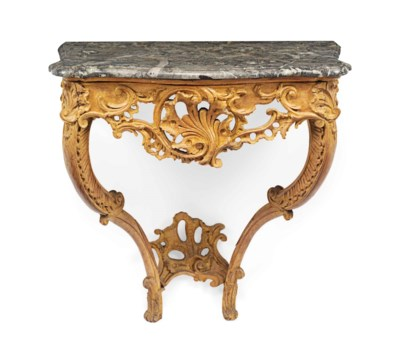 A LOUIS XV CARVED LIMEWOOD CON