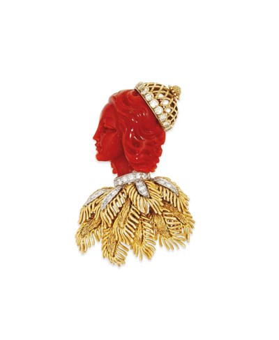A coral and diamond brooch