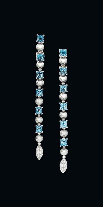 A pair of blue topaz and diamo
