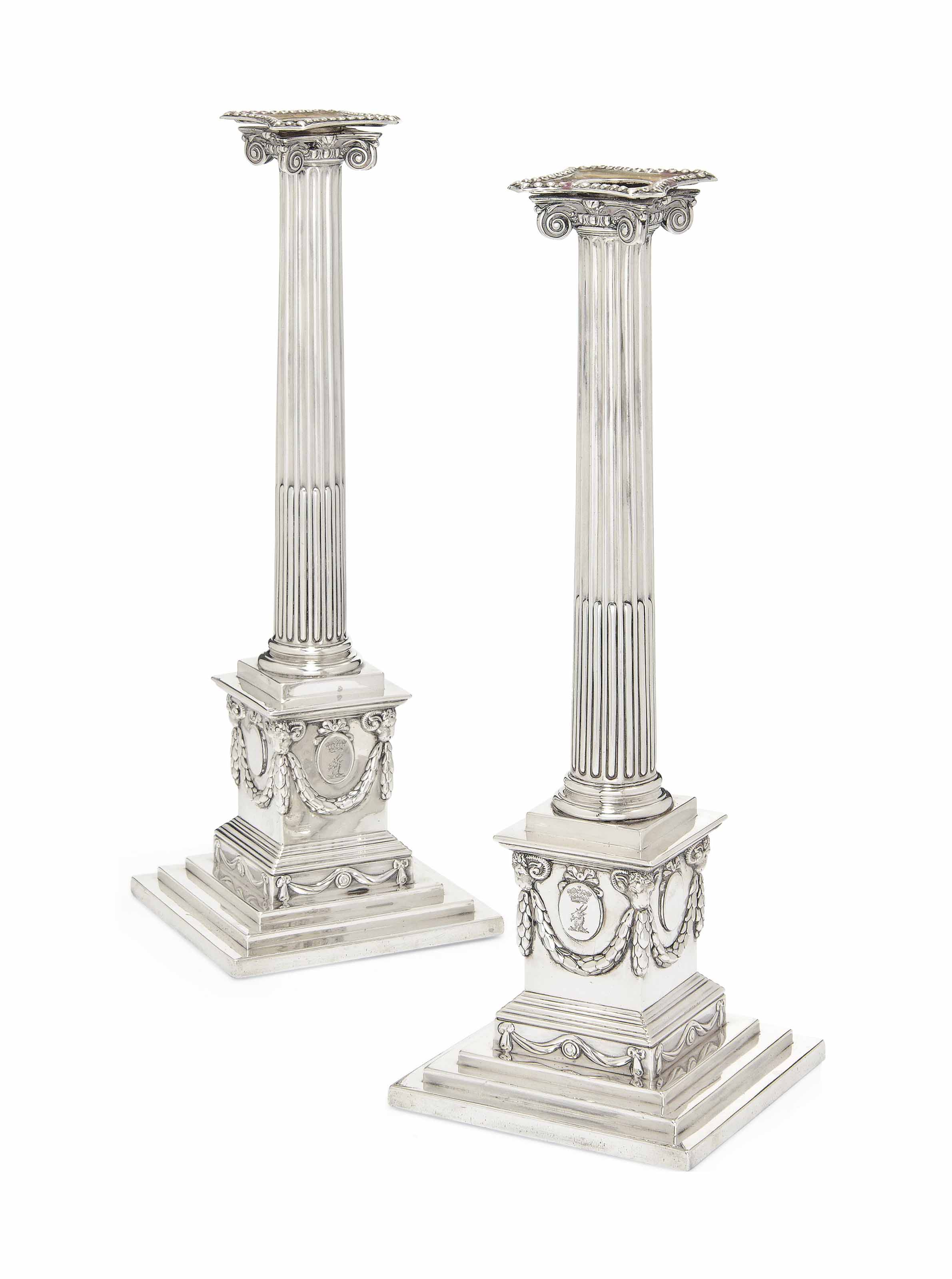 A PAIR OF GEORGE III IONIC COLUMN SILVER CANDLESTICKS