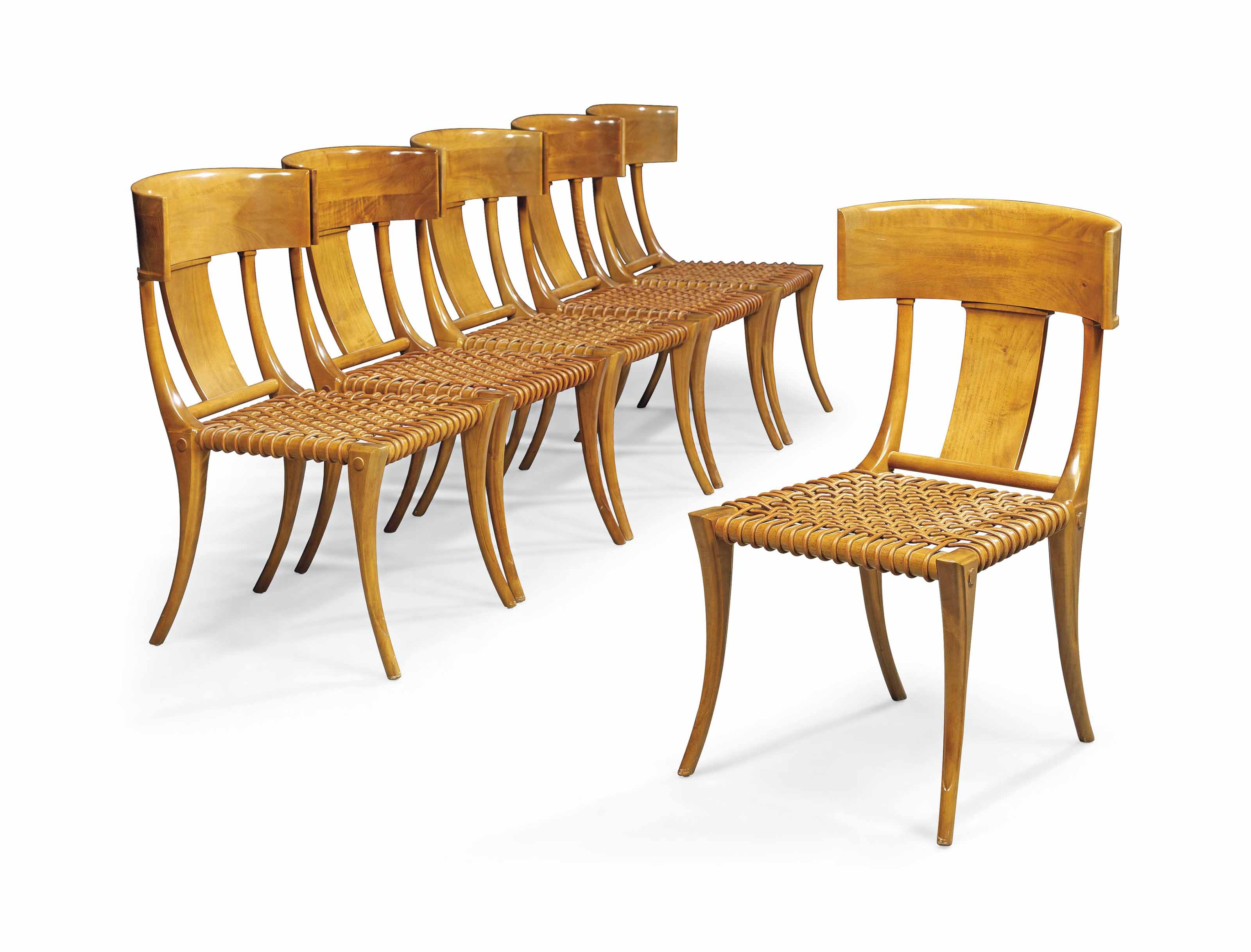 A SET OF SIX  T. H. ROBSJOHN-GIBBINGS (1905-1976) WALNUT KLISMOS' CHAIRS