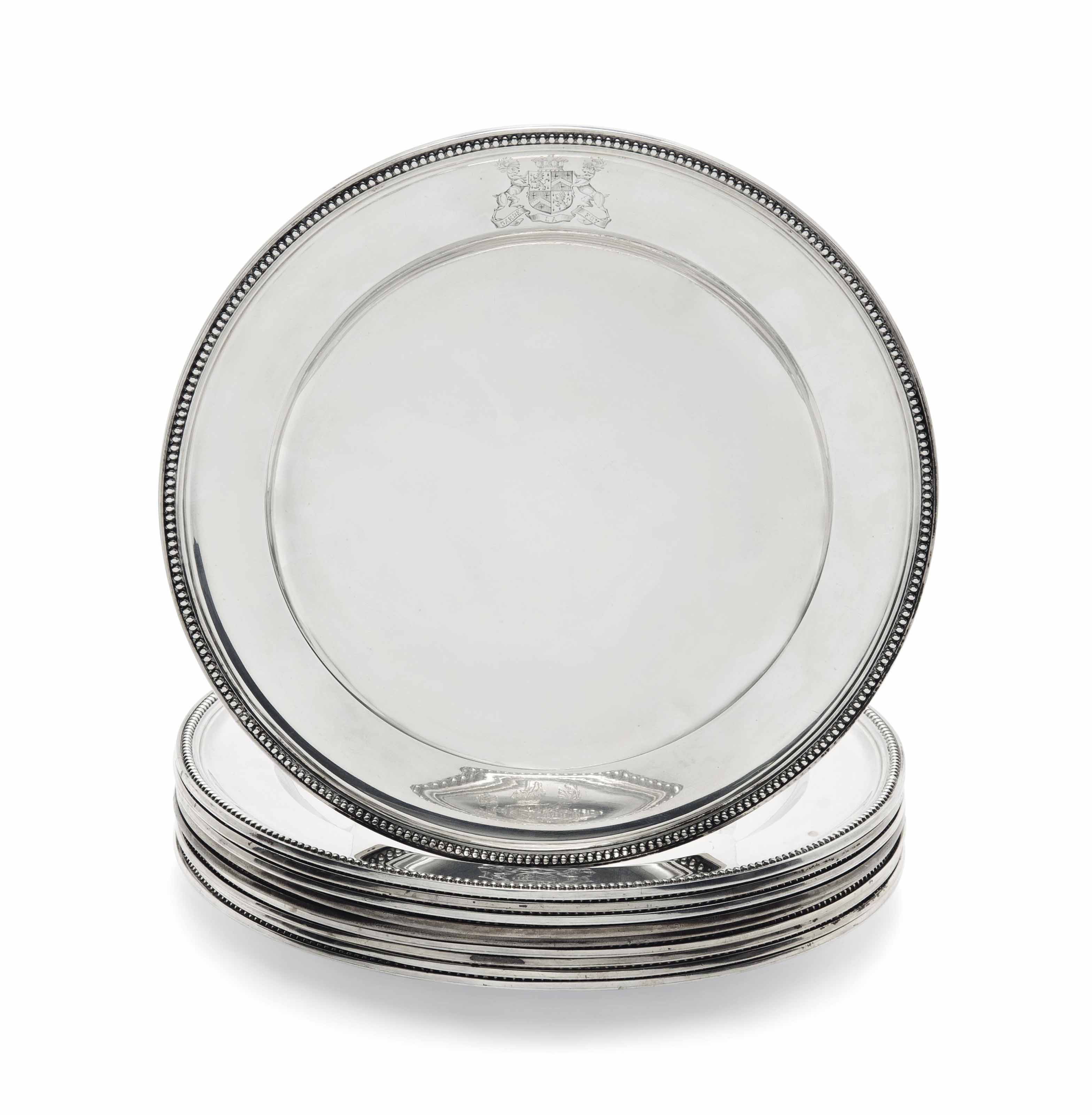 A SET OF TEN VICTORIAN SILVER DINNER PLATES
