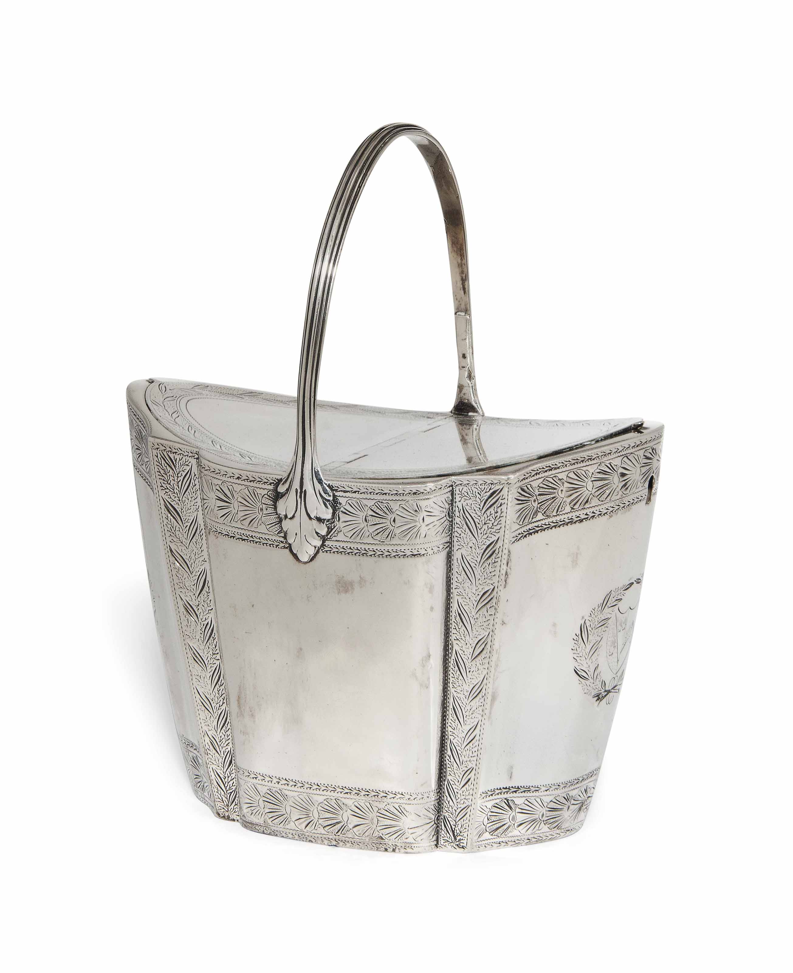 A GEORGE III SILVER TWIN-COMPARTMENT TEA CADDY WITH CENTRAL FIXED REEDED HANDLE