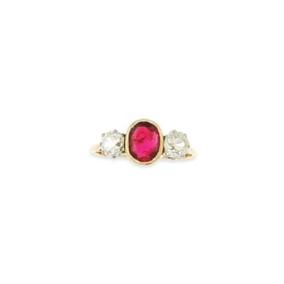 A ruby and diamond three stone