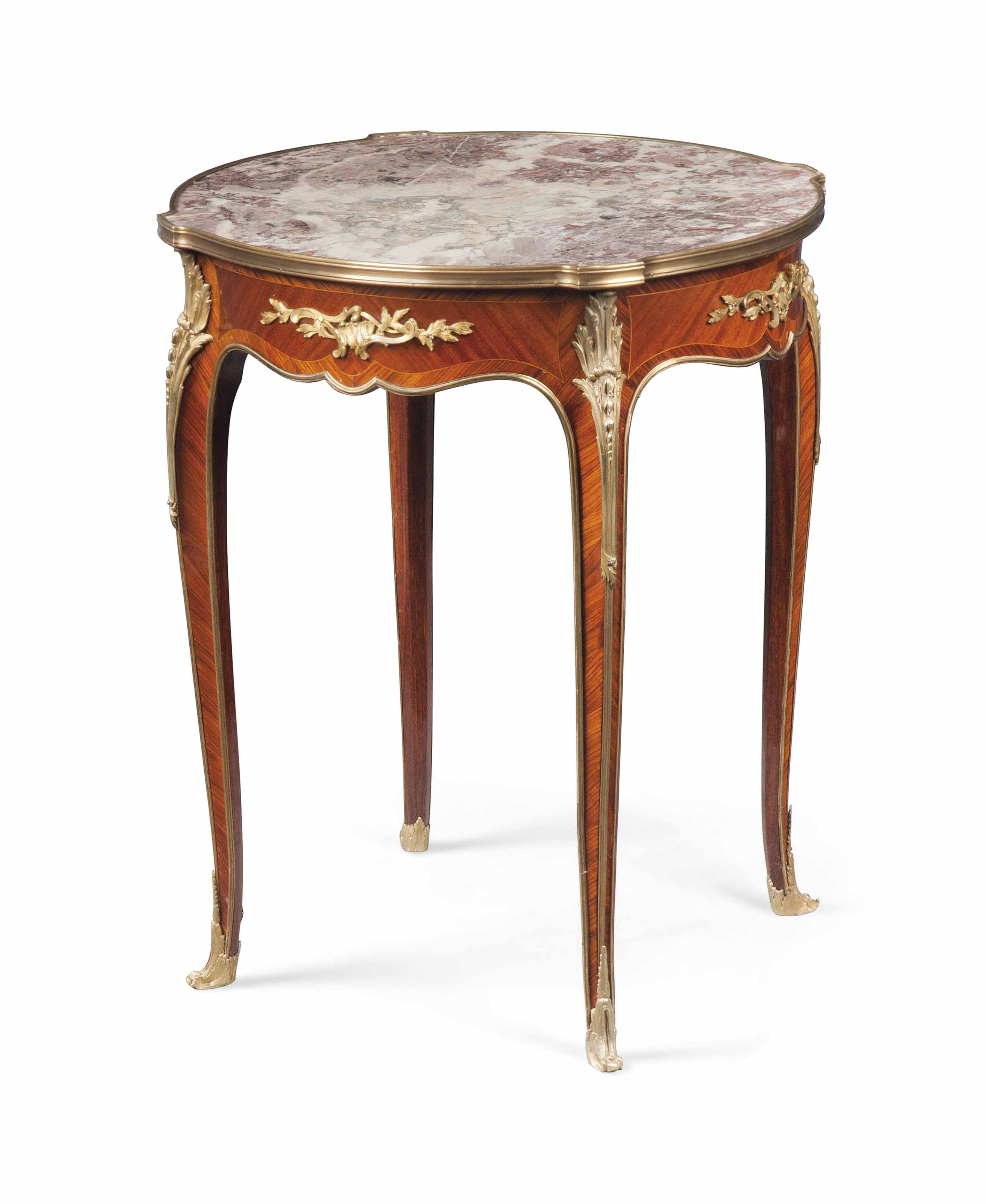A FRENCH ORMOLU-MOUNTED KINGWOOD AND BOIS SATINE GUERIDON