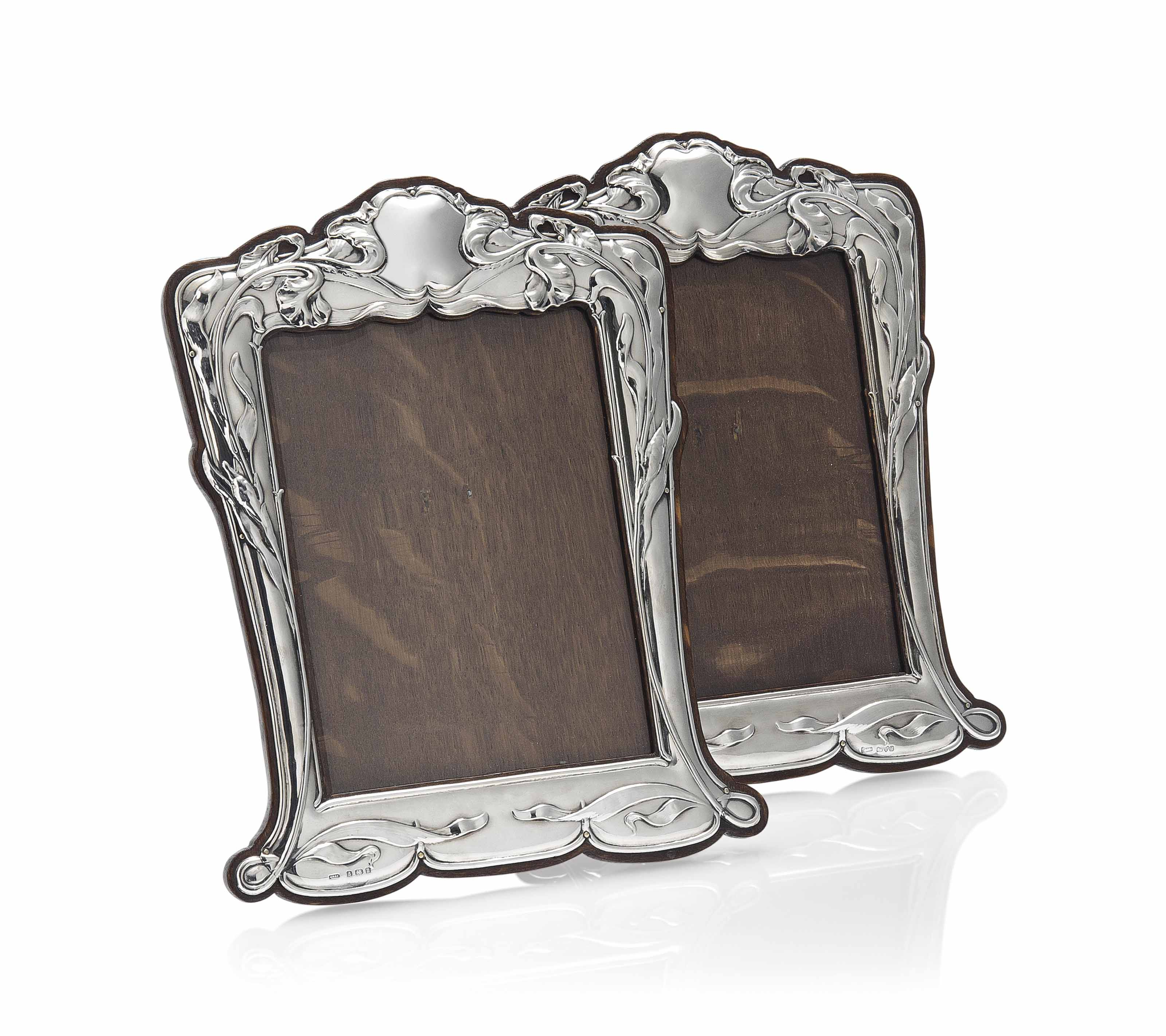 A MATCHED PAIR OF SILVER AND MAHOGANY PHOTOGRAPH FRAMES