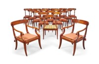 A SET OF EIGHTEEN OAK DINING CHAIRS