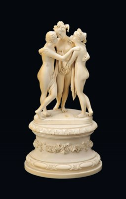 A FRENCH CARVED IVORY GROUP OF