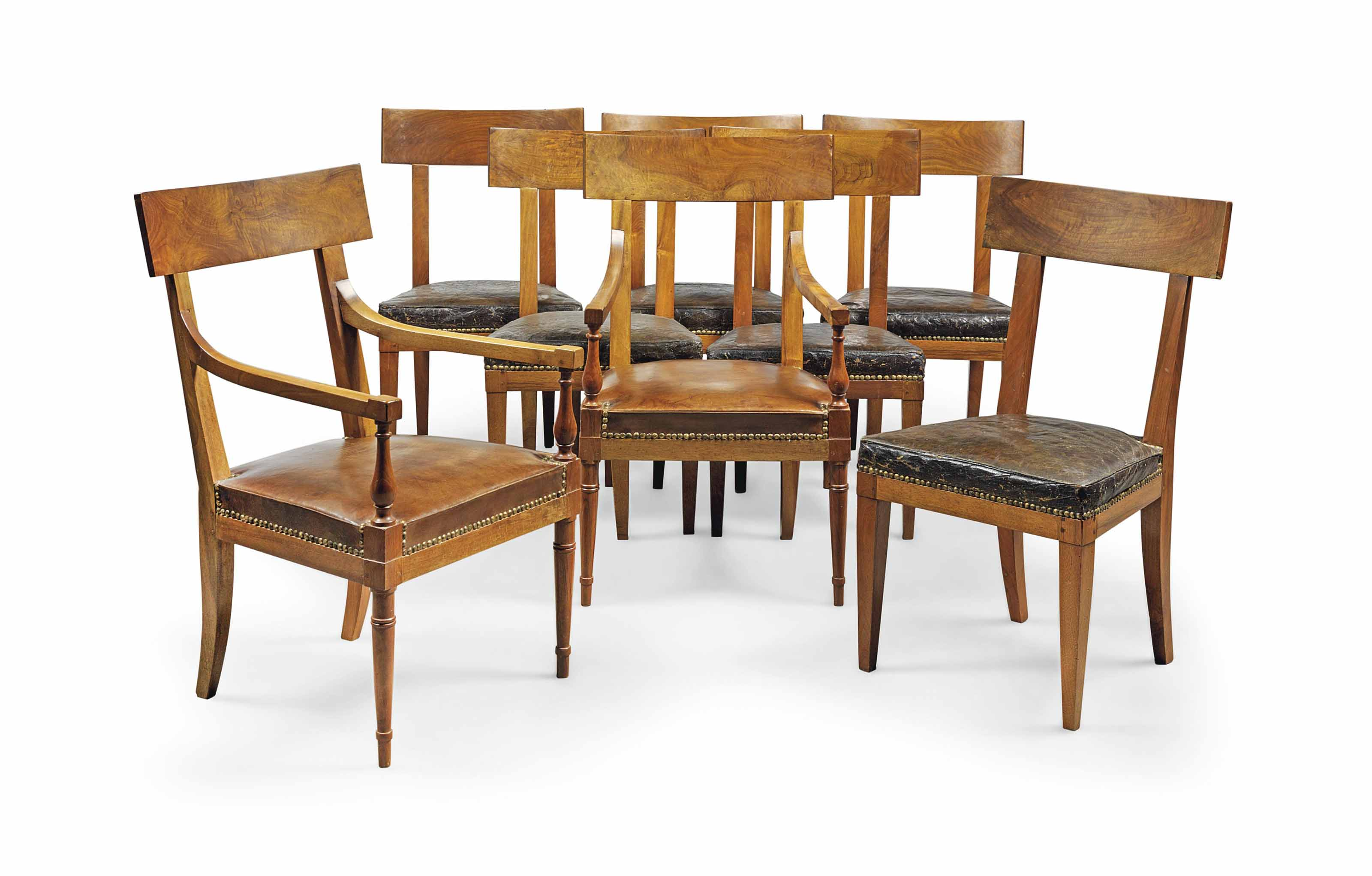 A SET OF SEVEN DIRECTOIRE WALNUT DINING CHAIRS