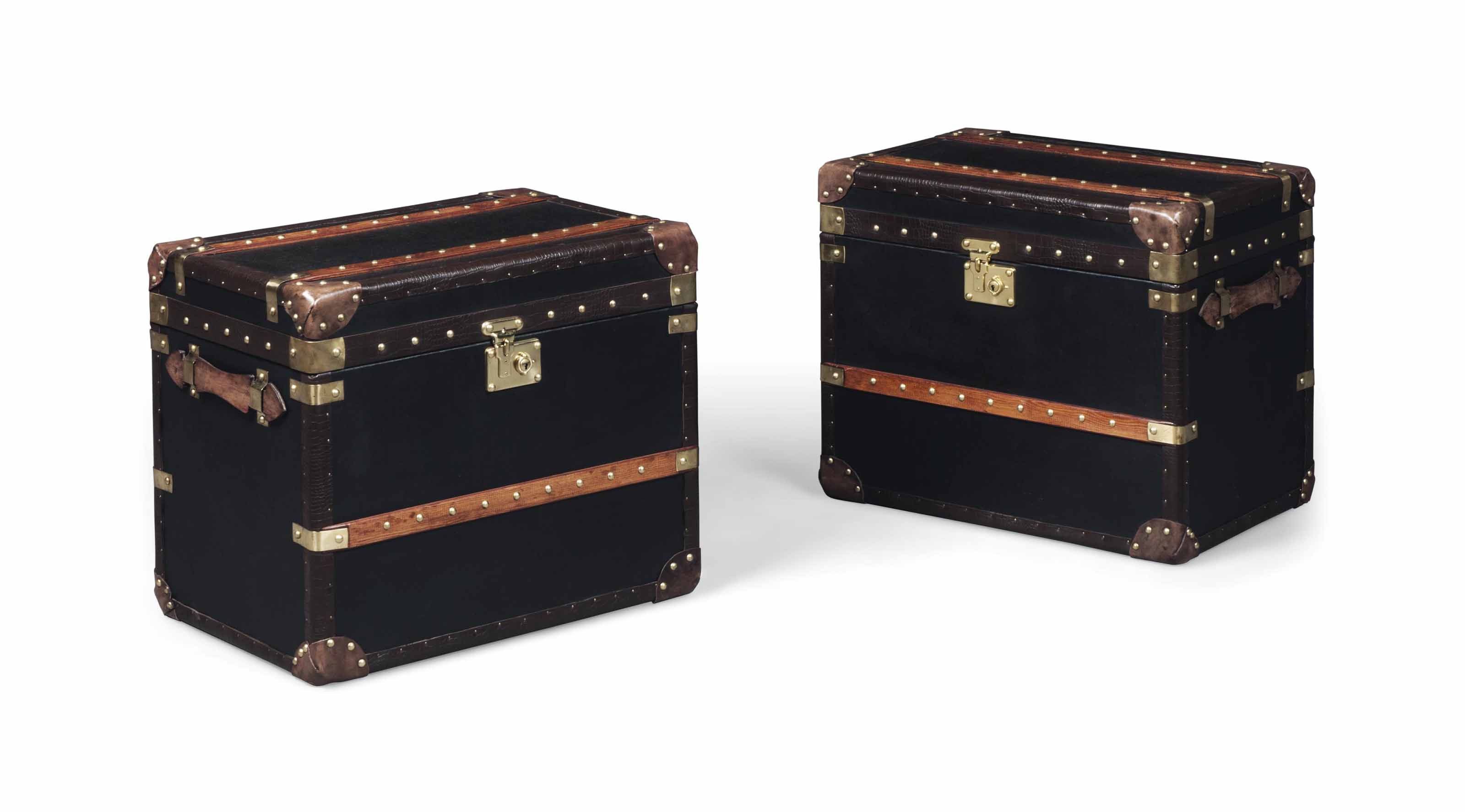 A PAIR OF BRASS-MOUNTED LEATHER TRUNKS