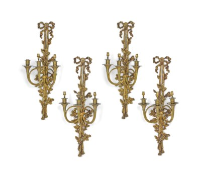 A SET OF FOUR GILT BRASS THREE