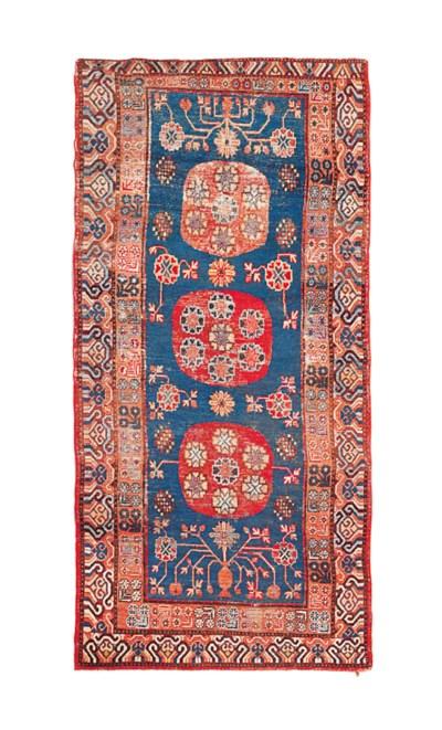 An antique Khotan rug