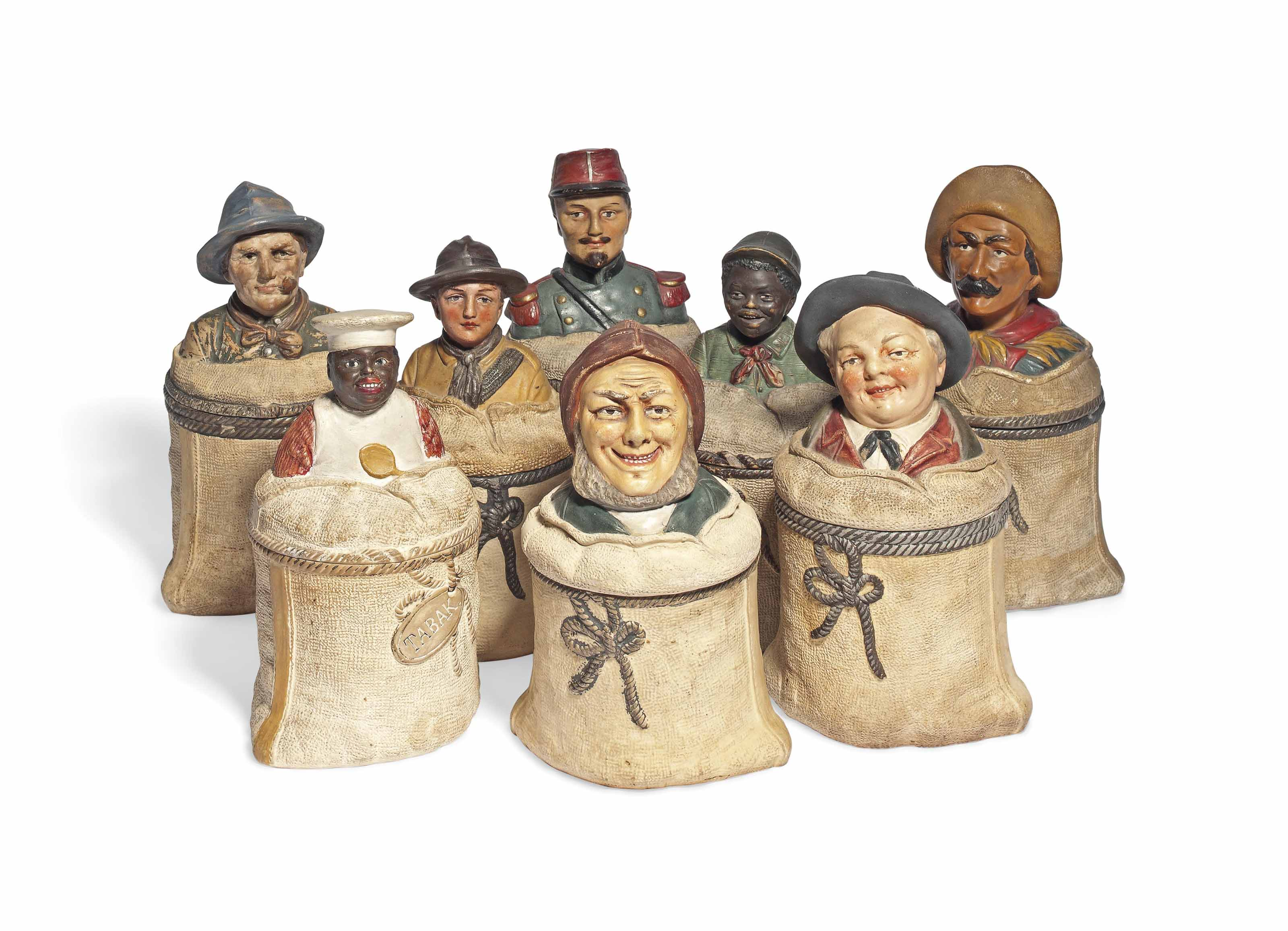 A GROUP OF EIGHT AUSTRIAN POLYCHROME DECORATED TOBACCO JARS