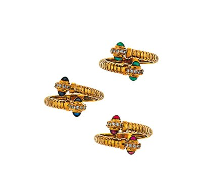 A group of gem-set bangles and