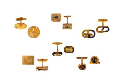 A group of nine pairs of cuffl