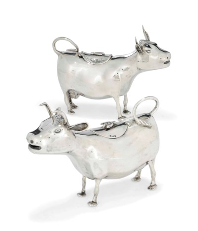 TWO DUTCH SILVER COW CREAM JUG