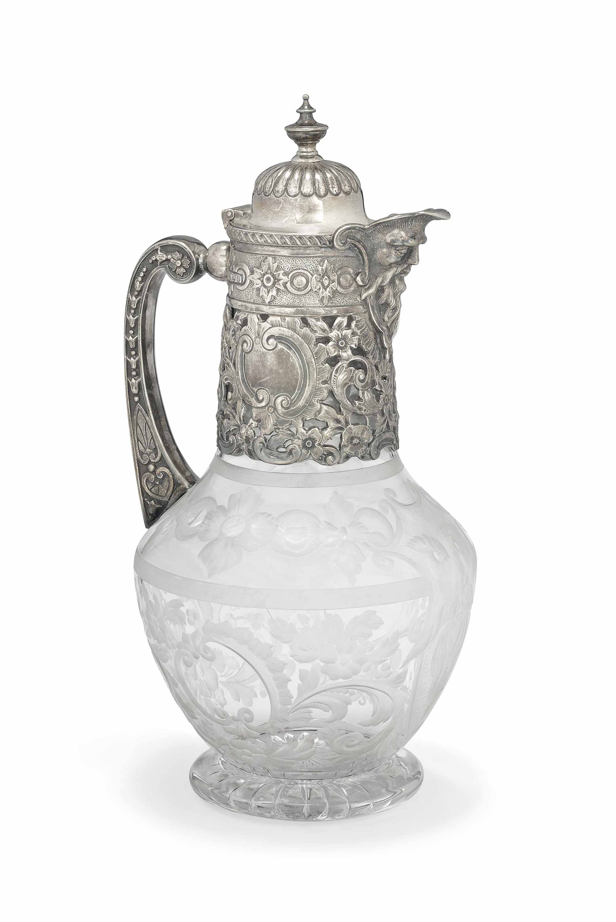 A LATE VICTORIAN SILVER-MOUNTED CLARET JUG