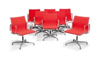 A SET OF EIGHT CHARLES & RAY EAMES ALUMINIUM AND FABRIC 'GROUP' ELBOW CHAIRS MADE BY HERMAN MILLER