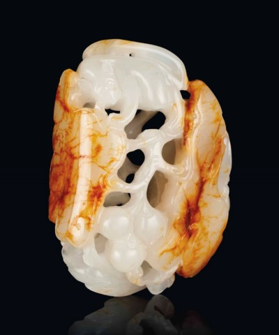 A WHITE AND RUSSET JADE 'SQUIR
