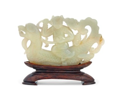 A PALE CELADON JADE CARVING OF