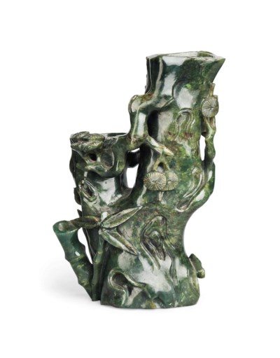 A SPINACH-GREEN JADE VASE