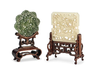TWO CARVED AND PIERCED JADE PL