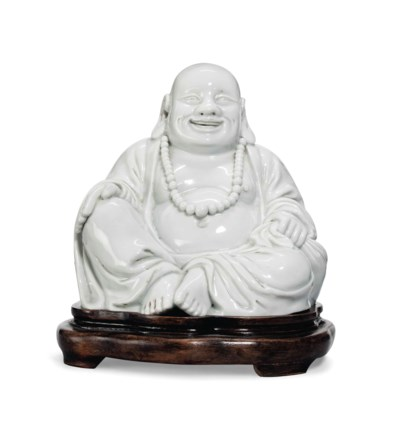A WHITE-GLAZED MODEL OF BUDAI
