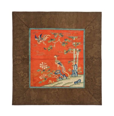 A RED-GROUND SILK EMBROIDERED