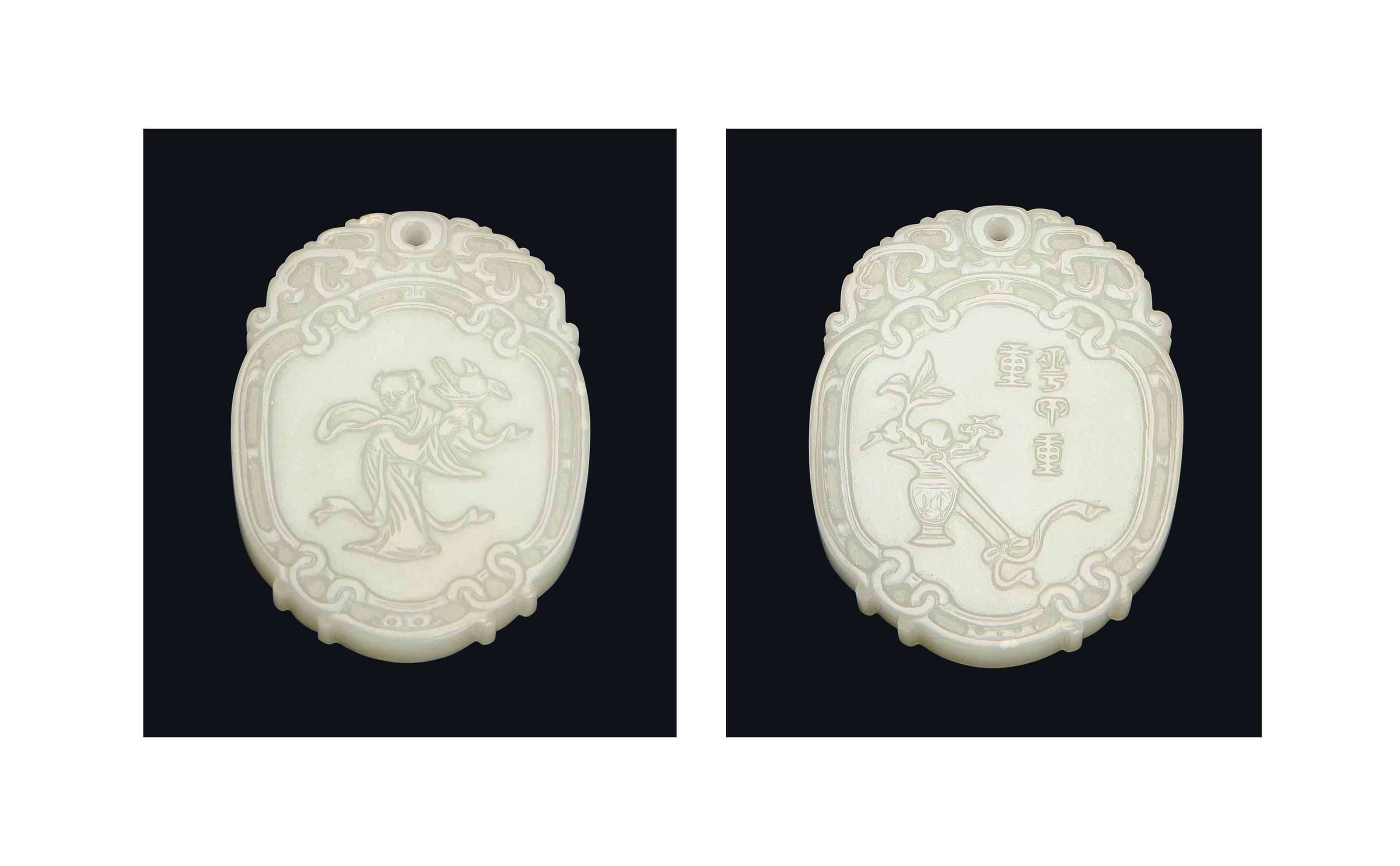 A CARVED WHITE JADE OVAL PLAQU
