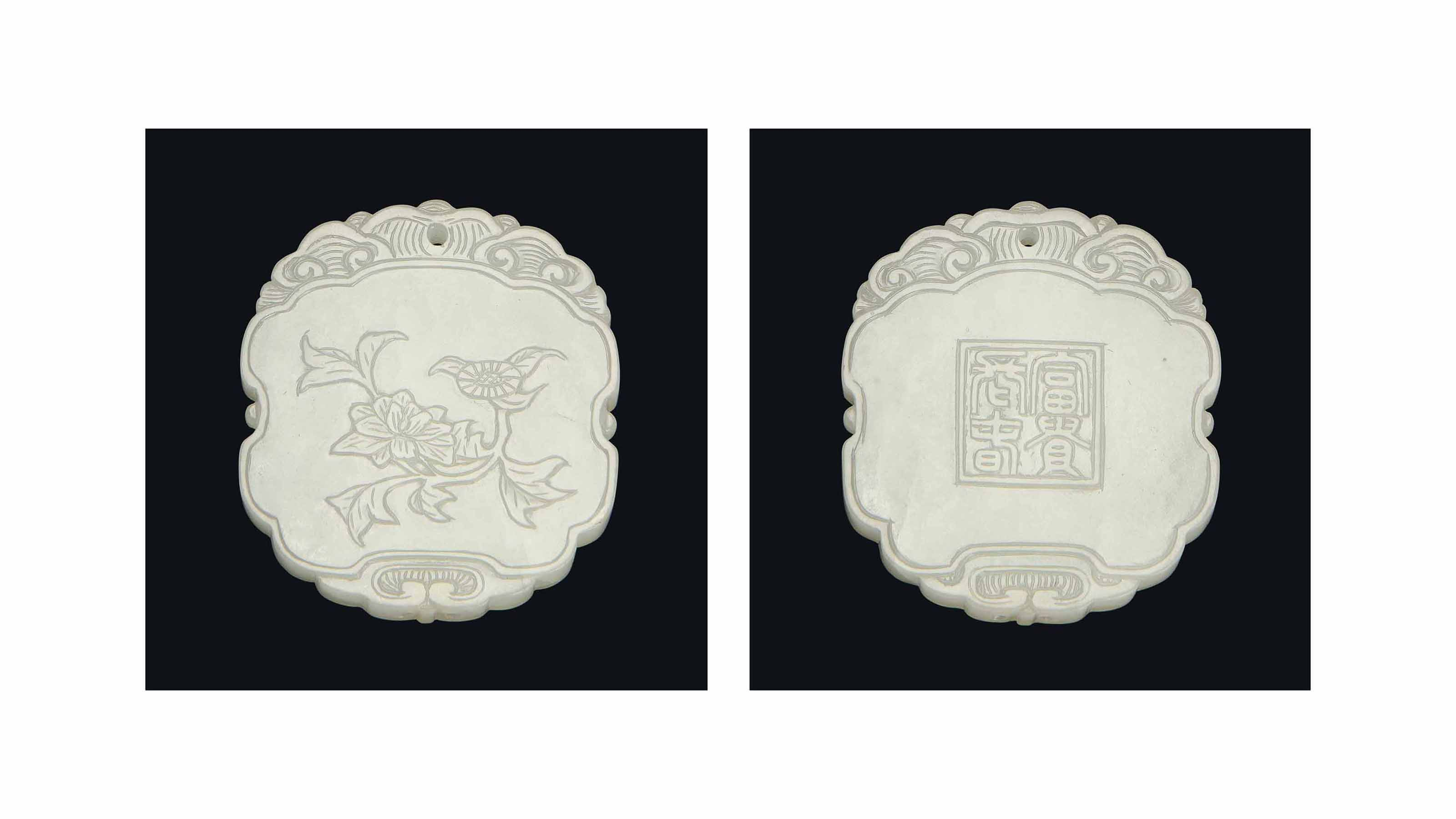 A WHITE JADE OVAL PLAQUE