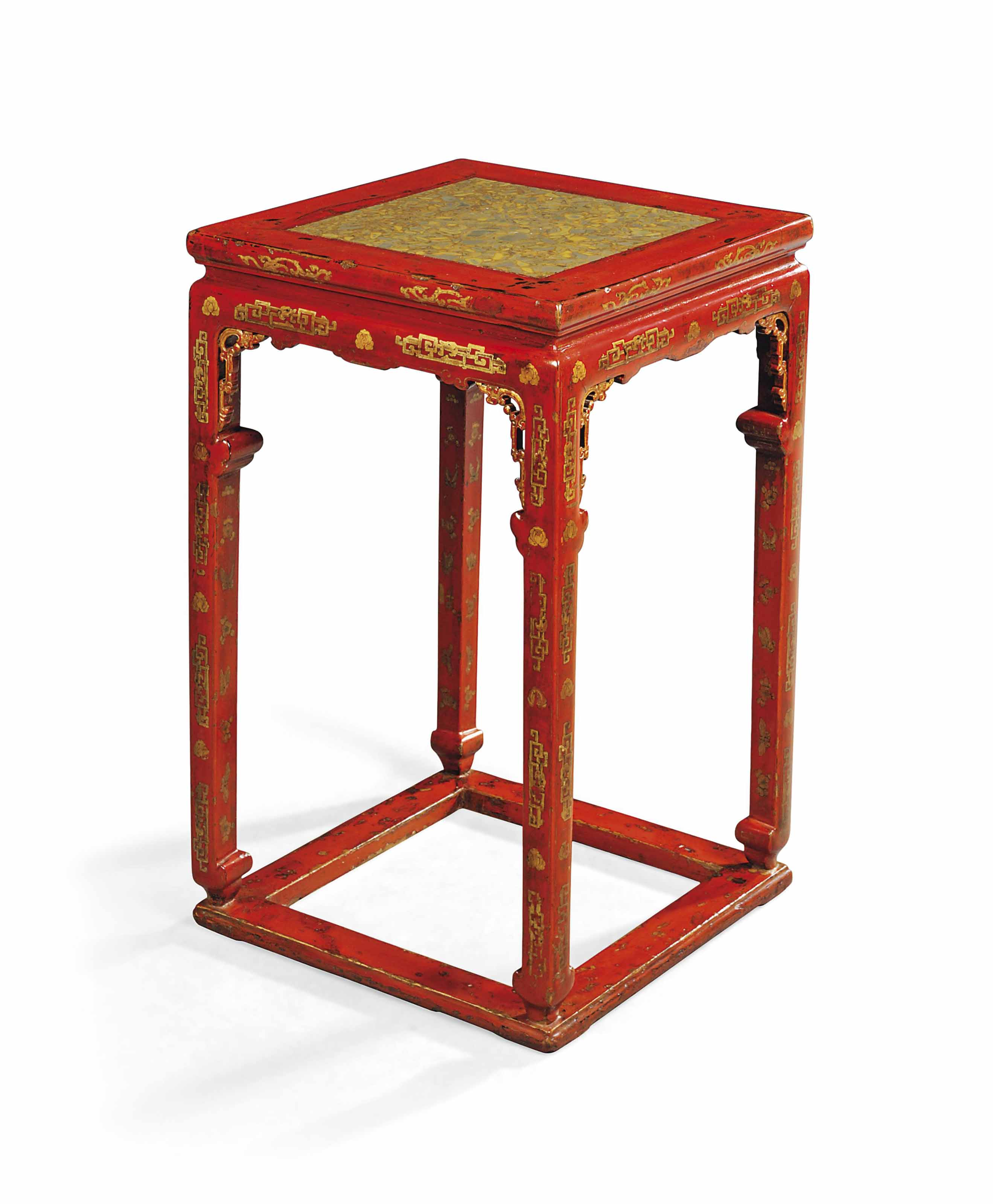 A RED GILT-LACQUERED STAND WIT