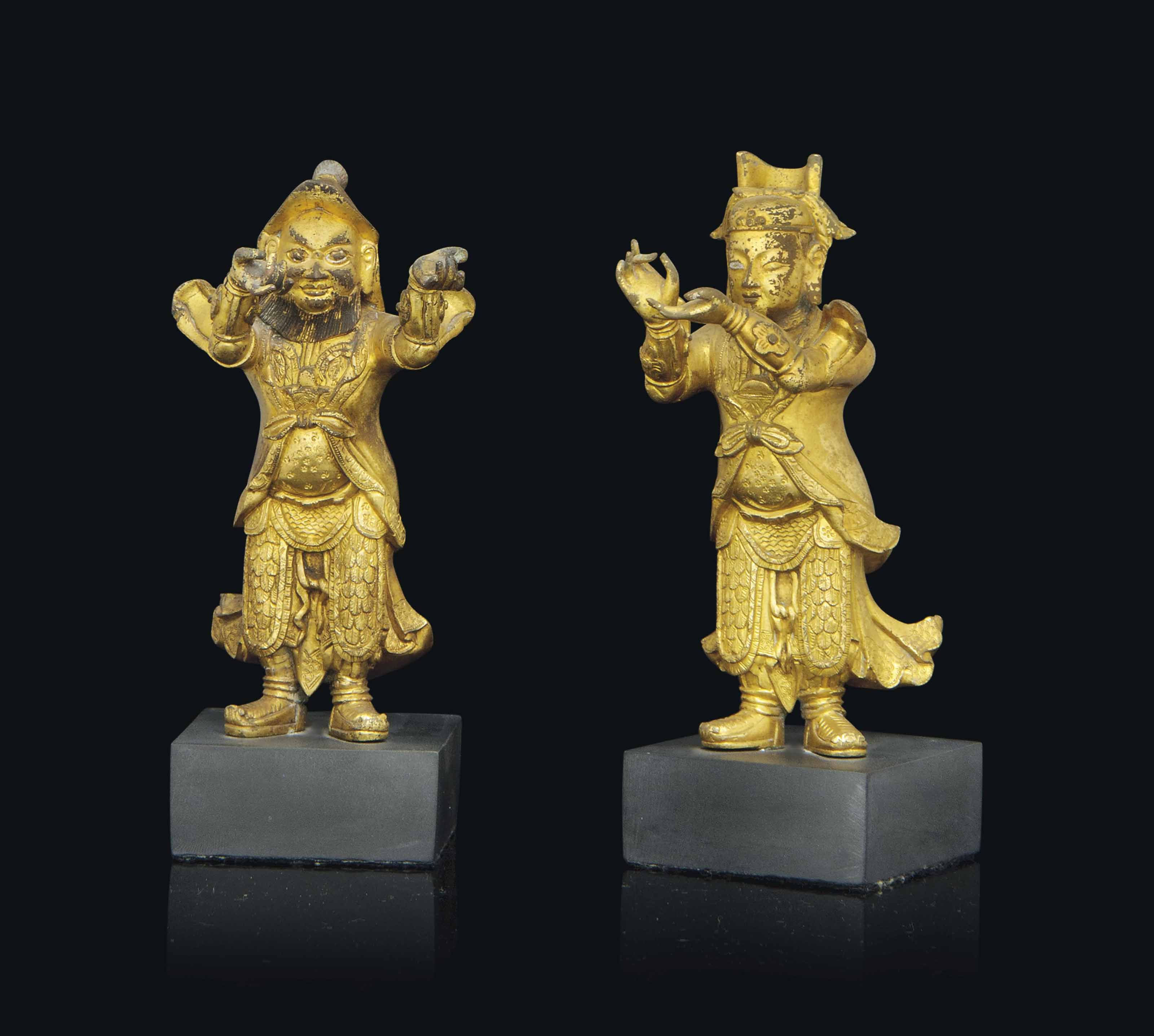 TWO GILT-BRONZE FIGURES OF GUA