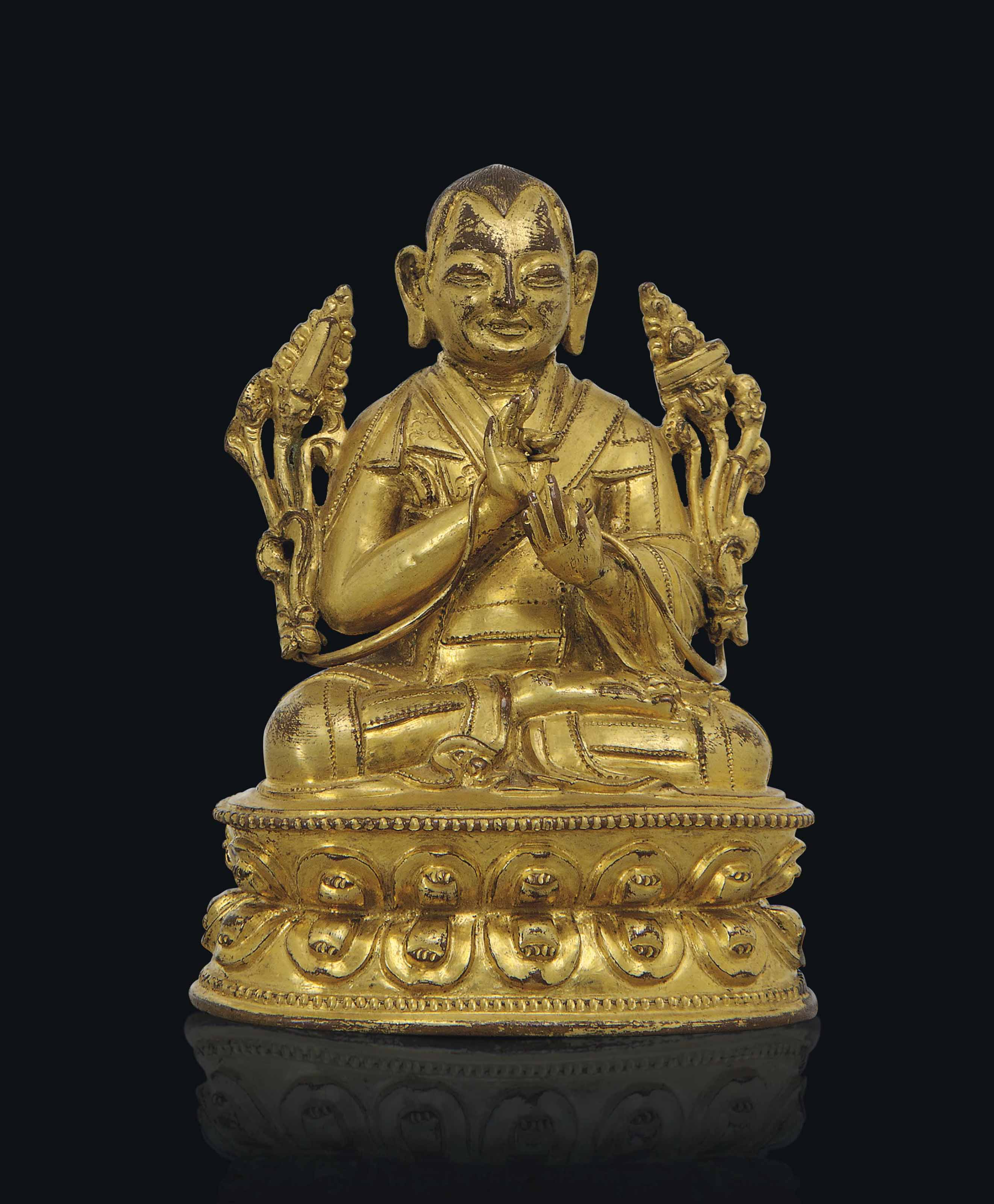 A GILT-BRONZE MODEL OF A LAMA