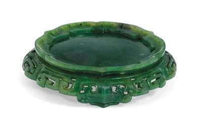 A SPINACH GREEN JADE CIRCULAR