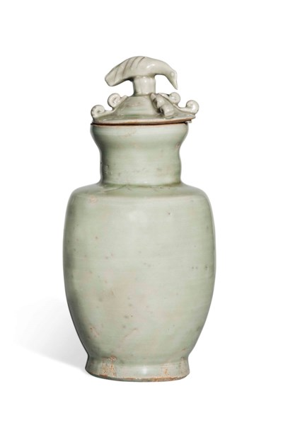 A CELADON-GLAZED JAR AND COVER