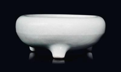 A WHITE-GLAZED TRIPOD CENSER