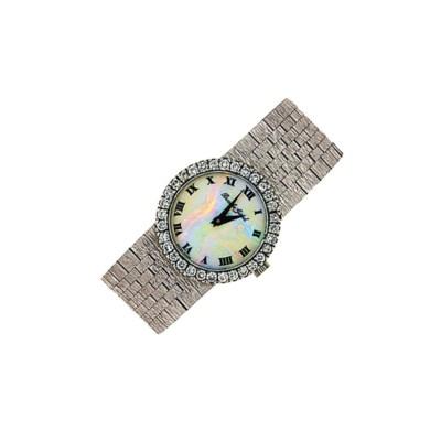 A diamond-set wristwatch, by B